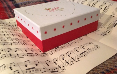 Box, sheet music, scissors, sellotape, ribbon, wrapping paper, upcycled