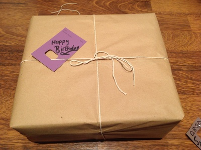 Brown paper packages, string, gift tags, paint chips, paint samples