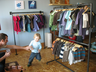 Child Playing Near Clothes - Credit: Mahalie Stackpole https://www.flickr.com/photos/mahalie/2068357349/