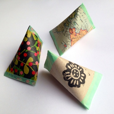 Cardboard tube pouch covered with world map, decorated recycled tube wrapping