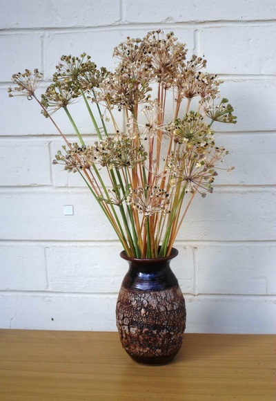 Vase of weeds sprayed green
