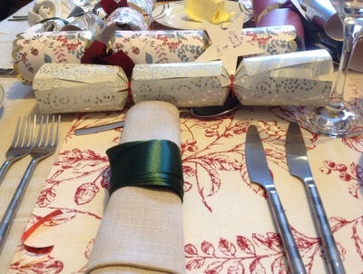 Natural tablecloth, hessian napkin, red berry runner, green ribbon