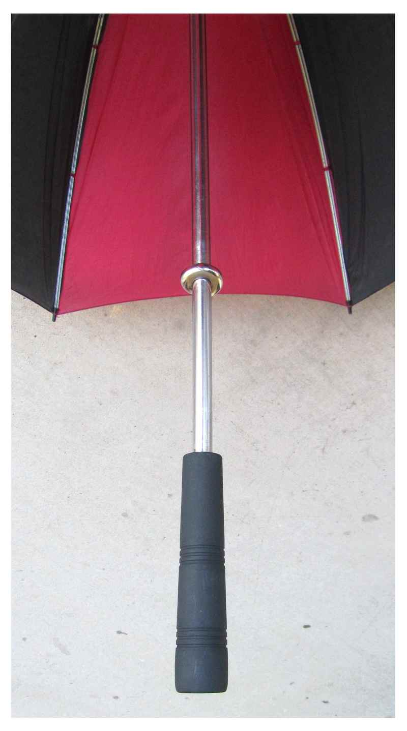 measuring tape around umbrella handle
