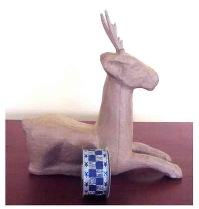 paper mache reindeer and ribbon