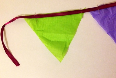 Pinning ribbon to ripstop fabric to make bunting