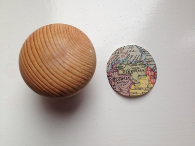 World map cupboard knob, craft made out of maps, world map cupboard pull, world map closet handle, homemade cupboard knob, world map craft ideas